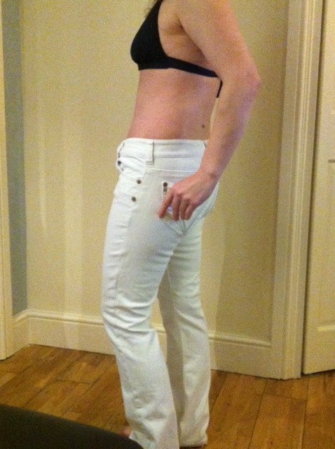 side view in white jeans